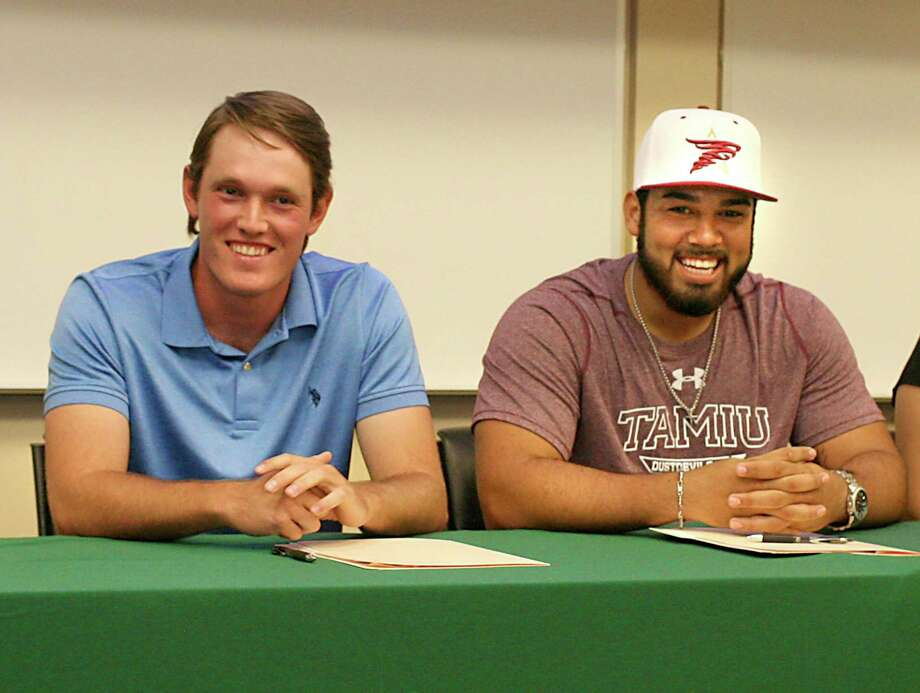 Caleb Rozypal and Matt Rosales moments before signing their letters of intent of playing for Prairie View A& and TAMIU, respectively, on Thursday afternoon at the Kazen Student Center at Laredo Community College. Photo: Francisco Vera, Staff Photographer / Laredo Morning Times / Laredo Morning Times
