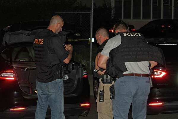 Police investigate a fatal shooting on Ely Avenue in South Norwalk on Thursday night.