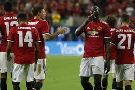 Manchester United forward Romelu Lukaku (9) celebrates his goal with fans during the first half of the 2017 International Champions Cup at NRG Stadium, Thursday, July, 20, 2017. ( Karen Warren / Houston Chronicle )