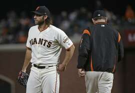 San Francisco Giants starting pitcher Madison Bumgarner, left, walks to the dugout after being removed by manager Bruce Bochy, right, during the seventh inning of the team's baseball game against the San Diego Padres on Thursday, July 20, 2017, in San Francisco. (AP Photo/Eric Risberg)