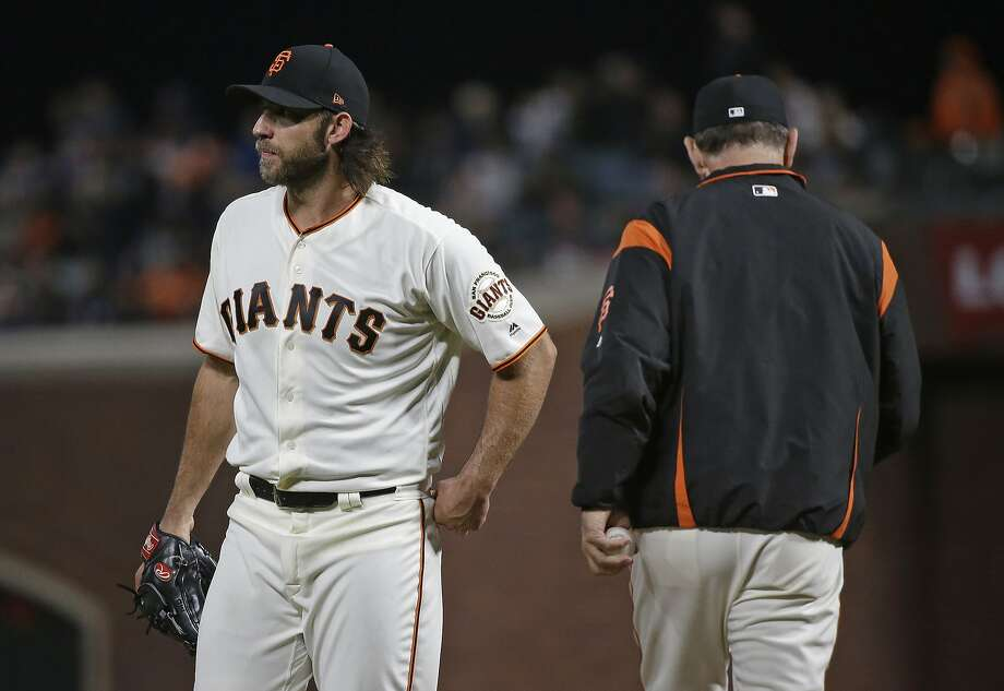 San Francisco Giants starting pitcher Madison Bumgarner, left, walks to the dugout after being removed by manager Bruce Bochy, right, during the seventh inning of the team's baseball game against the San Diego Padres on Thursday, July 20, 2017, in San Francisco.  Photo: Eric Risberg, Associated Press