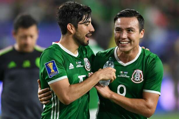 Mexico's Rodolfo Pizarro (L) and Erick Torres (R) celebrate their 1-0 victory over Honmduras in their quarterfinal CONCACAF Gold Cup match on July 20, 2017 at the University of Phoenix Stadium in Glendale, Arizona.  / AFP PHOTO / Robyn BeckROBYN BECK/AFP/Getty Images