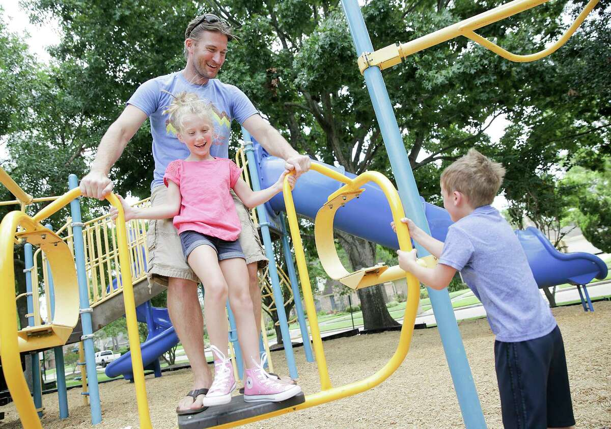 Ben Andrews plays his children Addison, 8, and Caleb, 6 on Thursday, July 20, 2017, in Pearland. Andrews, 38, was diagnosed with the same type of brain cancer Sen. John McCain has almost 2 years ago.