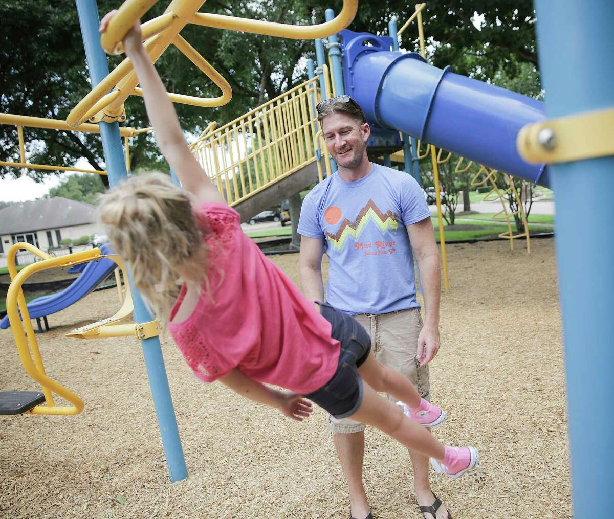 Ben Andrews watches his daughter, Addison, 8, as she plays on a swing set on Thursday, July 20, 2017, in Pearland. Andrews, 38, was diagnosed with the same type of brain cancer Sen. John McCain has almost 2 years ago.
