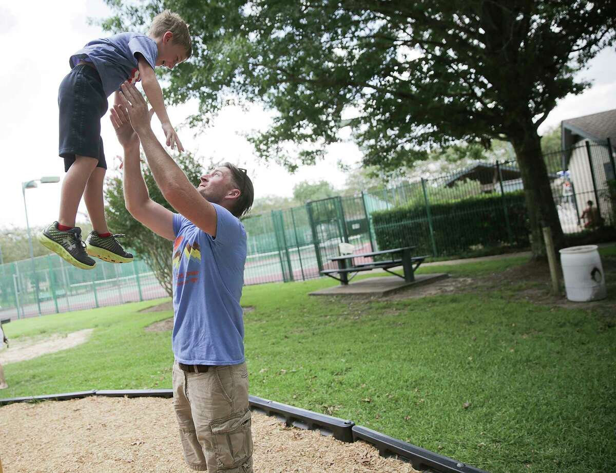 Ben Andrews plays with his son, Caleb, 6 on Thursday, July 20, 2017, in Pearland. Andrews, 38, was diagnosed with the same type of brain cancer Sen. John McCain has almost 2 years ago.