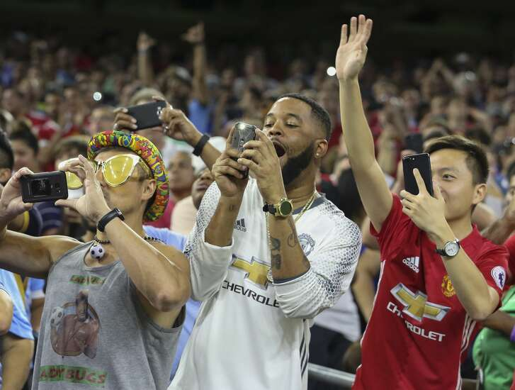 Manchester United fans are excited to see the players coming onto the field before the International Champions Cup game between Manchester City and Manchester United at NRG Stadium Thursday, July 20, 2017, in Houston. ( Yi-Chin Lee / Houston Chronicle )
