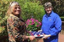 The New Milford Andrew B. Mygatt VFW Post 1672 recently presented a new flag to the Odd Fellows Good Shepherd Lodge #65 in town. The flag will replace the lodges tattered flag. VFW auxiliary president Pat Brought, right, hands the donated flag to Cindy Day, secretary of the Odd Fellows Lodge.