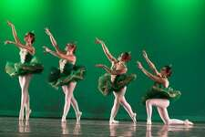 """Dancers from Studio D in New Milford perform a scene from """"No Place in Home,"""" an adaptation of """"The Wizard of Oz,"""" at New Milford High School. They are, from left to right, Gabriela Esposito, Elizabeth Hawley, Maria Pellegrino and Emmie Tesoriero."""