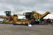 Youth Sugarbeet Project participants get an up-close view of a Ropa Maus (left) and Ropa Tiger self-propelled harvester (right) during the 2017 program. (Submitted Photo)