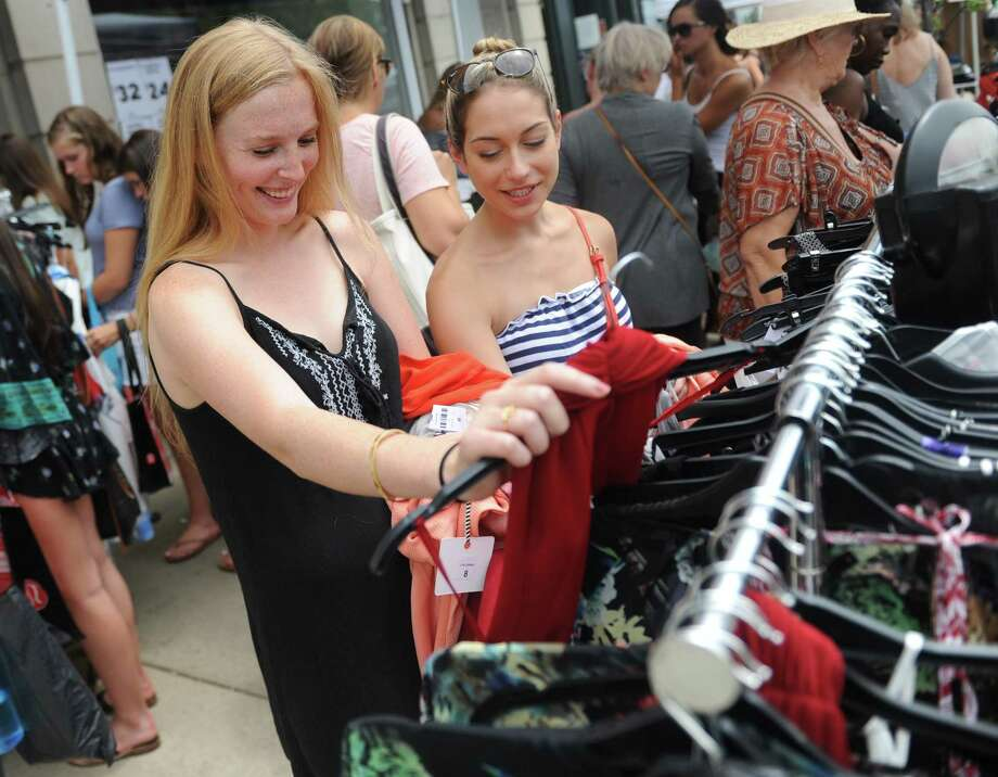 Greenwich's Jenna Ragen, left, and Darien's Katrina Vassell shop at LF during opening day of the 2017 Sidewalk Sale Days on Greenwich Avenue July 13. More than 120 merchants along and near The Avenue are participating in the sale, offering discounts on clothing, jewelry, accessories, gifts. Photo: Tyler Sizemore / Hearst Connecticut Media / Greenwich Time