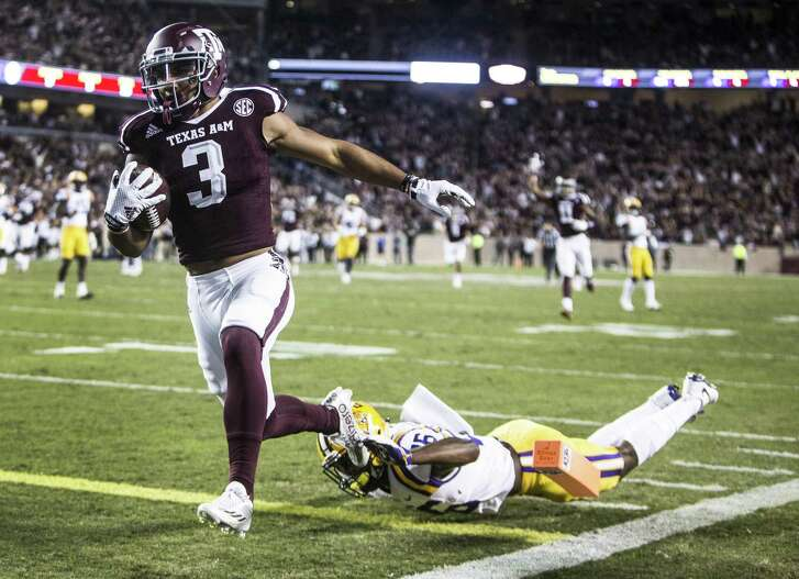 Texas A&M wide receiver Christian Kirk (3) breaks past LSU safety John Battle for a 36-yard touchdown reception during the first quarter at Kyle Field on Nov. 24, 2016, in College Station.