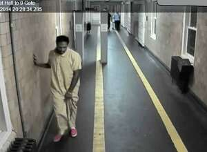 Mark Cannon, 24, staggers though the Albany County Correctional Facility after falling ill. The video was captured at 8:28 p.m. on Aug. 26, 2014.