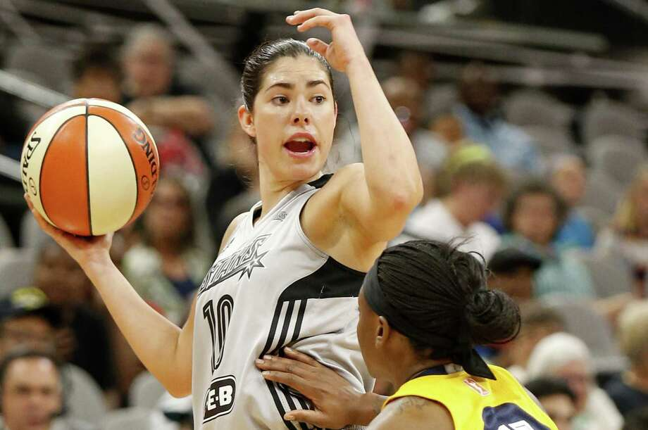 San Antonio Stars' Kelsey Plum calls a play during first half action as the Indiana Fever's Erica Wheeler defends on July 20, 2017 at the AT&T Center. Photo: Edward A. Ornelas /San Antonio Express-News / © 2017 San Antonio Express-News