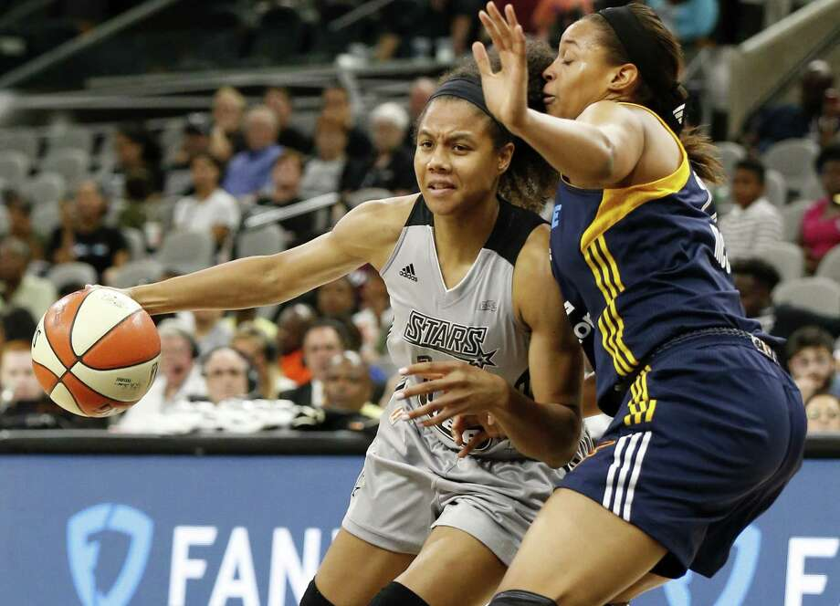 Stars' Nia Coffey looks for room around the Indiana Fever's Erica McCall during second half action on July 20, 2017 at the AT&T Center. The Stars won 85-61. Photo: Edward A. Ornelas /San Antonio Express-News / © 2017 San Antonio Express-News