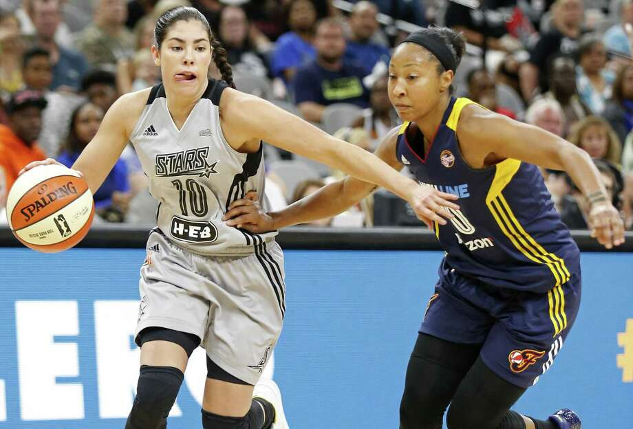 San Antonio StarsÕ Kelsey Plum drives around Indiana FeverÕs Briann January during first half action Thursday July 20, 2017 at the AT&T Center. Photo: Edward A. Ornelas, Staff / San Antonio Express-News / © 2017 San Antonio Express-News