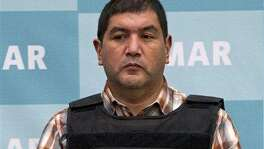 "The alleged leader of a faction of the Zetas cartel, Iván Velázquez Caballero, known as ""El Taliban,"" seen during a media presentation at the Mexican Navy's Center for Advanced Naval Studies in Mexico City on Sept. 27, 2012, received 30 years for drug trafficking and money laundering charges."