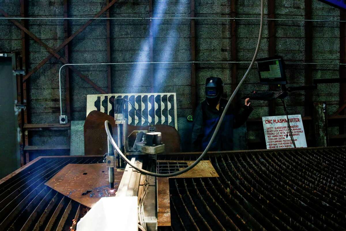 Development director Lauren Caldarera runs the plasma cutter at TX/RX, a space for people to build, fabricate and create.
