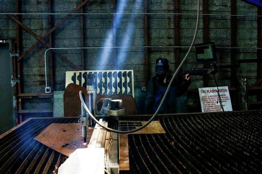 TX/RX development director Lauren Caldarera runs the plasma cutter at TX/RX, a maker space for people to build, fabricate and and create, Friday, June 30, 2017 in Houston. ( Michael Ciaglo / Houston Chronicle ) Photo: Michael Ciaglo, Staff / Michael Ciaglo