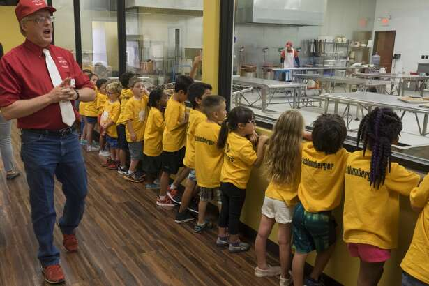 John Curtis, packaging manager with Susie's South Forty, gives a tour and talks about the candy making process  6/22/17 to 4 and 5 year olds from the YMCA. Tim Fischer/Reporter-Telegram
