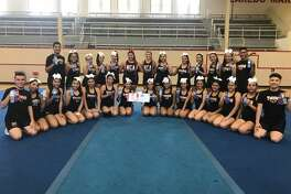 Martin High School cheerleaders participate in an NCA cheer-intensive at the school and received an invitation to participate at the NCA Nationals in Dallas in January.