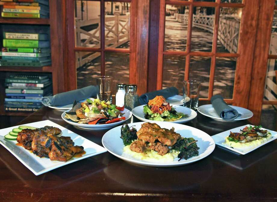 Signature fare in the library at Braeburn Tavern on  Broadway Thursday July 13, 2017 in Saratoga Springs, NY.  (John Carl D'Annibale / Times Union) Photo: John Carl D'Annibale / 20041034A