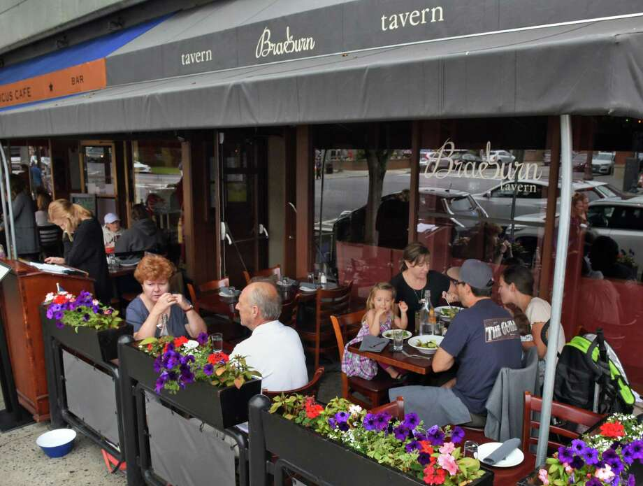 Diners on the patio at Braeburn Tavern on  Broadway Thursday July 13, 2017 in Saratoga Springs, NY.  (John Carl D'Annibale / Times Union) Photo: John Carl D'Annibale / 20041034A
