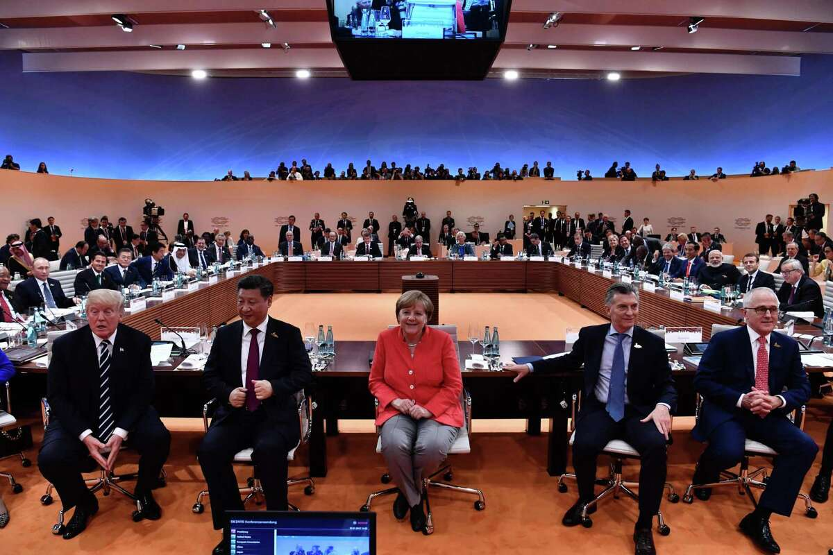 U.S. President Donald Trump, from left, China's President Xi Jinping, German Chancellor Angela Merkel, Argentinia's President Mauricio Macri and Australia's Prime Minister Malcolm Turnbull turn around for photographers at the start of the first working session of the G20 meeting in Hamburg, northern Germany, on July 7.