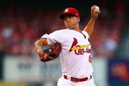 Starter Marco Gonzales #56 of the St. Louis Cardinals delivers a pitch against the Milwaukee Brewers in the first inning at Busch Stadium on June 13, 2017 in St. Louis, Missouri.  (Photo by Dilip Vishwanat/Getty Images)