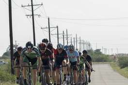 Riders make their way along county roads south of Midland with members of the Permian Basin Bicycle Association. The group rides allow bicyclists to form relationships with others who share the same hobby, members say.