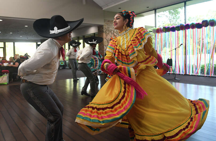 "Jose' Sada, from left, and Aliza Meshania, of Mixteco Ballet Folklorico School of Dance in Houston, perform during the Crosby Huffman Chamber of Commerce ""Fiesta La Divas"" at the Newport Country Club in Crosby on July 20, 2017. (Photo by Jerry Baker/Freelance) Photo: Jerry Baker, Freelance / Freelance"