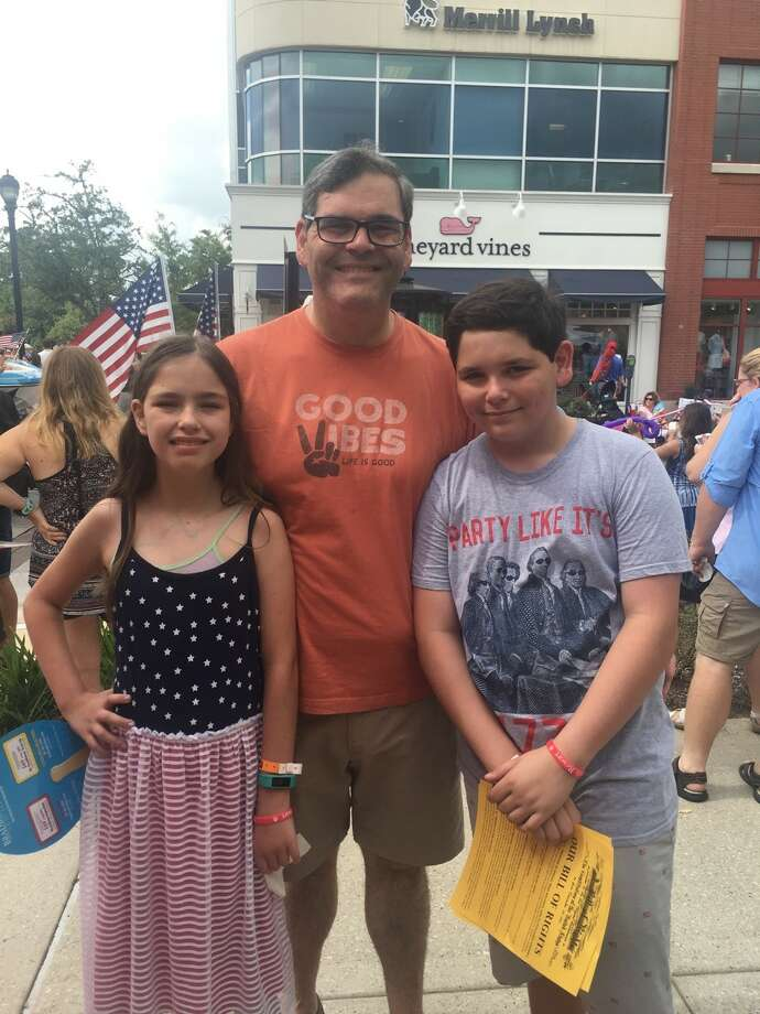 Beth Wolff, Realtors Ed Wolff and his twins Tenley and Jake joined with the company's Woodlands office in celebrating Independence Day at Hughes Landing.
