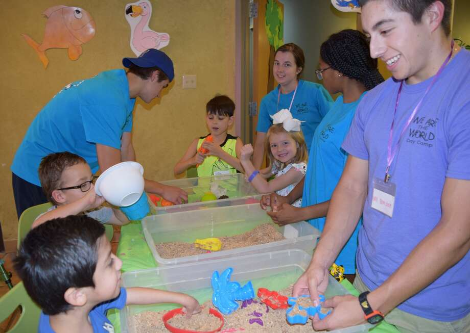 Volunteers, Worker Bees and Campers work with sand art. (L to R, front to back) Xaden Lopez, Christian du Preez. Evan Witt. Jathan Vargas, Tiara Doucet, Harper Coulter, Ligaya Barnes and Braidon Clemence Photo: Courtesy Photo