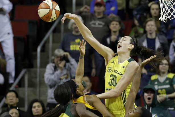 Seattle Storm's Breanna Stewart blocks a shot by Indiana Fever's Briann January in the final minute of a WNBA basketball game Sunday, May 14, 2017, in Seattle. The Storm won 87-82. (AP Photo/Elaine Thompson)