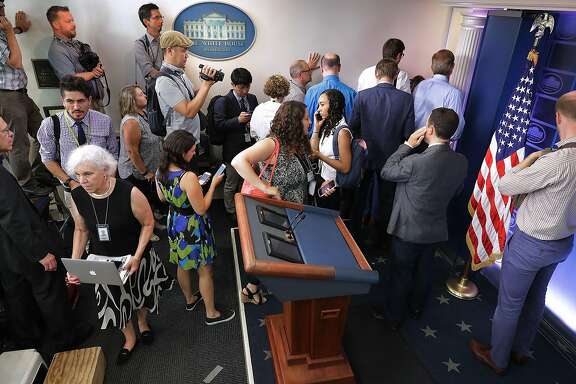 WASHINGTON, DC - JULY 21:  Journalists stand outside the entrance to the White House press office after it was learned that Press Secretary Sean Spicer has resigned July 21, 2017 in Washington, DC. Reports say that Spicer quit after disagreeing with President Donald Trump's decision to hire Anthony Scaramucci, a Wall Street financier and longtime supporter, to the position of White House communications director  (Photo by Chip Somodevilla/Getty Images)