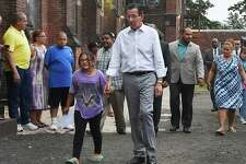 Gov. Dannel P.  Malloy walks with Hayley Chavarria, 9, before speaking at a press conference, Thursday, July 20, 2017, at Iglesia de Dios Pentecostal Church in Fair Haven where Hayley's mother Nury Chavarria, who was supposed to be deported today to Guatemala, has taken sanctuary. The Pentecostal church is only a temporary sanctuary, according to advocates.
