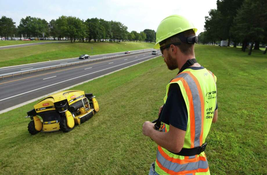 Michael Cavanaugh, with the New York State Office of General Services, operates a remote-controlled lawnmower at the Harriman Campus along Route 85 on Friday, July 21, 2017, in Albany, N.Y. (Will Waldron/Times Union) Photo: Will Waldron, Albany Times Union / 20041075A