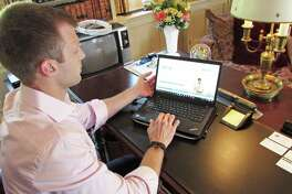 Hunt Scanlon Media's Chief Digital Officer Mike Wasulko gives an overview of how the firm's newest product, job search platform Ezayo, works at the company's offices, located in Greenwich, Conn., on Wed., July 19, 2017.