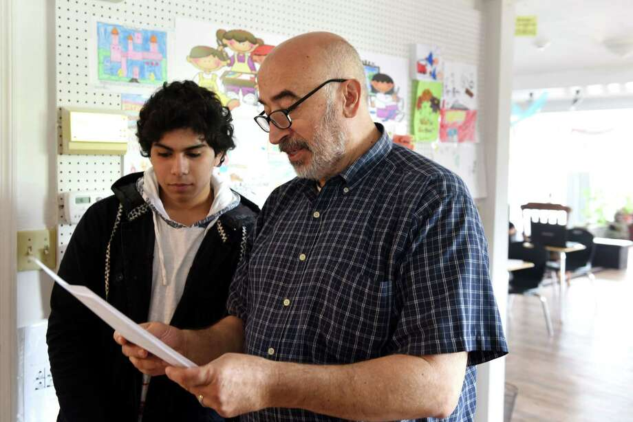 Anas Zorqane, 15, of Schenectady is tutored by Walid Hawana, right, co-founder and principal of the Bright Hope Center Academy on Friday, July 21, 2017, on Central Ave. in Schenectady, N.Y. (Will Waldron/Times Union) Photo: Will Waldron, Albany Times Union / 20041103A