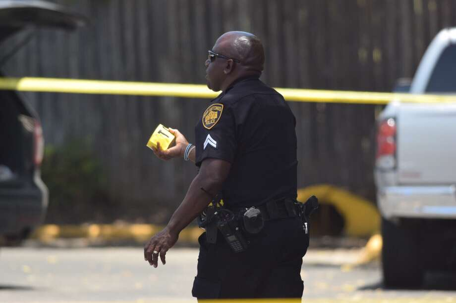 Police on Friday responded to a shooting at a Motel 6 in the 100 block of North W.W. White Road, where a man was discovered unresponsive, lying in a pool of his own blood at the scene. Photo: Caleb Downs / San Antonio Express-News