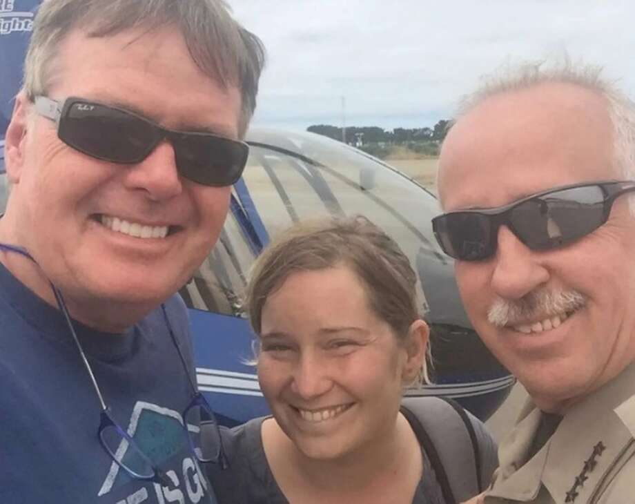 Amy Nuttbrock, 40, survived more than two days in the Oregon wilderness after getting lost during a day hike. At right is one of her rescuers, Curry County Sheriff John Ward. Photo: Curry County Sheriff's Office