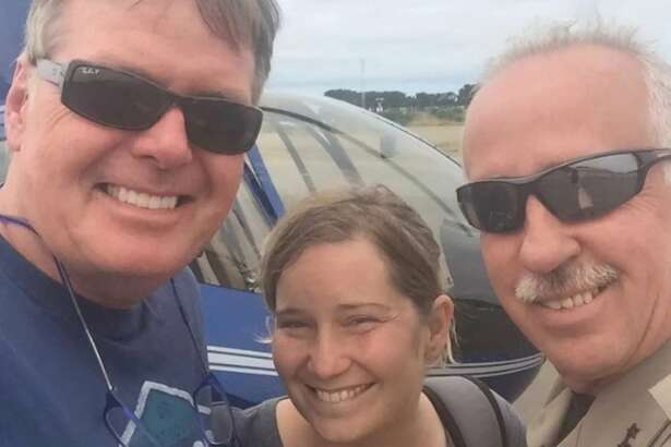 Amy Nuttbrock, 40, survived more than two days in the Oregon wilderness after getting lost during a day hike. At right is one of her rescuers, Curry County Sheriff John Ward.