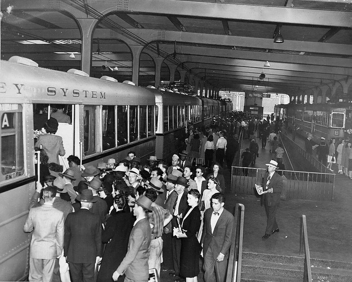 Travelers in 1939 board a Key System train inside the Transbay Terminal in San Francisco.