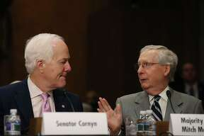 WASHINGTON — Senate Majority Leader Mitch McConnell, R-Ky., and Sen. John Cornyn, R-Texas, attend a Foreign Relations Committee comfirmation hearing for ambassadorships on June 20, 2017. They are working closely on drafting a new health care plan to replace the Affordable Care Act.
