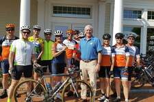 Jacqui Dowd, President of the Ridgefield Bicycle Sport Club; Charlie Taney, Executive Director of the NRVT; pictured with members of the Ridgefield Bicycle Sport Club.
