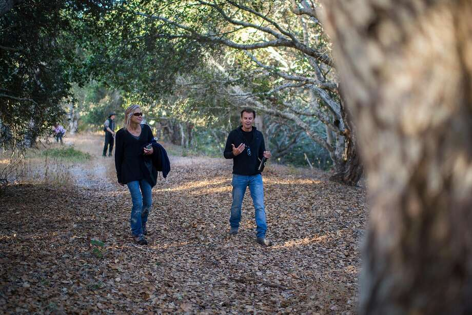 Developer Nick Jekogian (right) talks with sculptor Michelle Armitage during a hike through Walden Monterey. Photo: Nic Coury, Special To The Chronicle