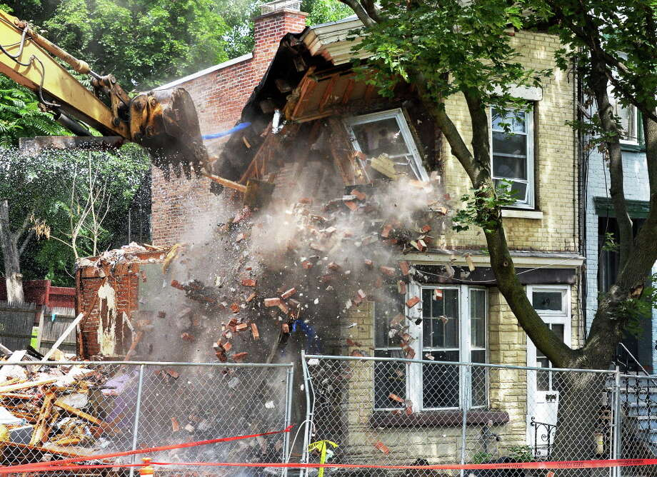 Crews demolish a home at 49 Second Street for deemed on the verge of collapse by Albany officials Friday July 21, 2017 in Albany, NY.  (John Carl D'Annibale / Times Union) Photo: John Carl D'Annibale, Albany Times Union / 20041106A