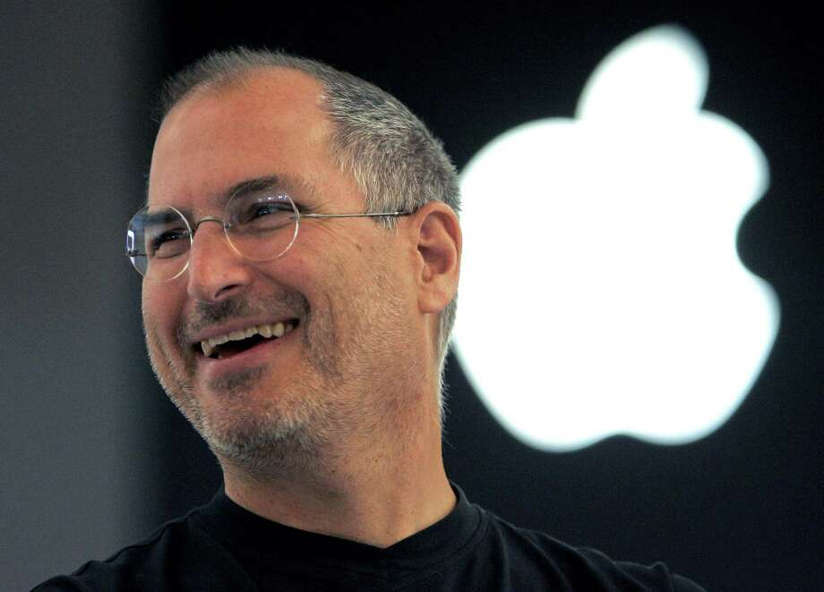 FILE - In this Sept. 20, 2005 file photo, Apple co-founder Steve Jobs smiles after a press conference as he opens the Apple Expo in Paris. Since his death in 2011, Jobs has been the subject of documentaries, books, a film, even a graphic novel. Now the technology pioneer will be the focus of an upcoming opera. In front of the Sangre de Cristo mountains in northern New Mexico, the Santa Fe Opera announced Wednesday, Aug. 5, that its latest commission will be based on the man who helped revolutionize personal computers, the music business and, of course, brought the world the iPhone. Photo: Christophe Ena /Associated Press / AP