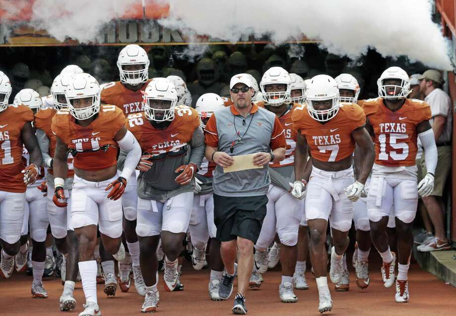 Coach Tom Herman leads his players onto the field for the Longhorns' Orange-White spring game on April 15, 2017, in Austin. Photo: Tom Reel /San Antonio Express-News / 2017 SAN ANTONIO EXPRESS-NEWS