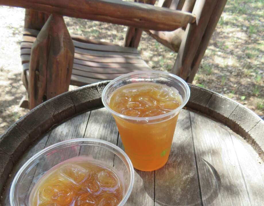 Get a flight of whiskey or spike your iced lemonade or peach tea and sit a spell in the rockers at Garrison Brothers Distillery in Hye, Texas. Photo: Terry Scott Bertling / San Antonio Express-News