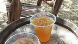 Get a flight of whiskey or spike your iced lemonade or peach tea and sit a spell in the rockers at Garrison Brothers Distillery in Hye, Texas.